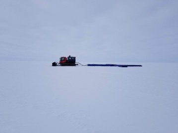 Chris pulling the radar across the ice sheet