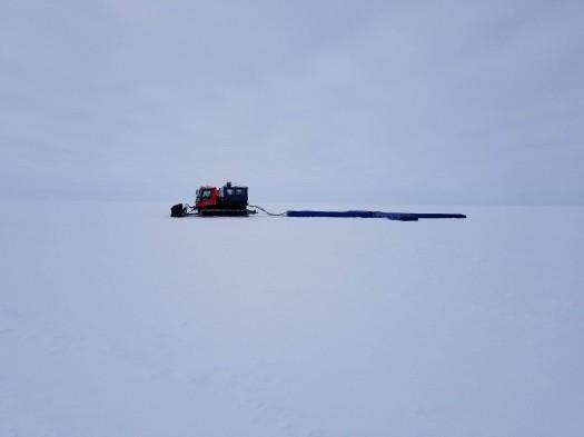 Chris pulling the radar across the ice sheet